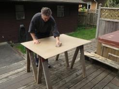 In this case I'm doing a 36x48. I give it a light sanding. in preparation for priming.