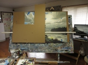 Working on a piece this big (36x48) can be a little overwhelming at times. I will often crop down to certain parts of the painting, to zero in on them so to speak in order keep me on track. This is easily done with L - shaped pieces of cardboard as in this photo